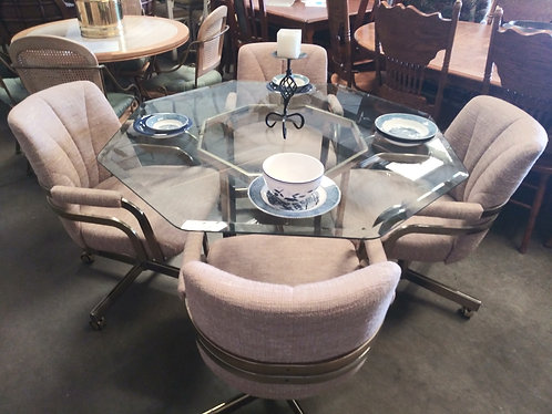 nice glass top table with 4 chairs