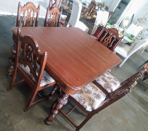Absolutely gorgeous solid wood dining room table with 6 palm tree chairs