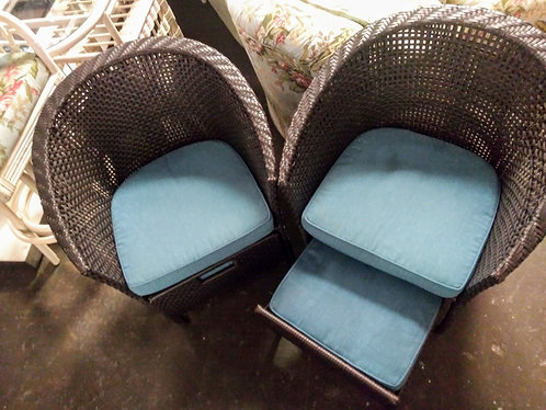 Super cute rattan arm chairs with built-in ottomans!