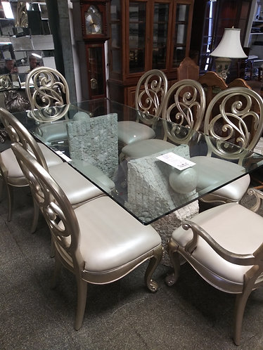 One of a kind glasstop table with 8 gold and beige chairs