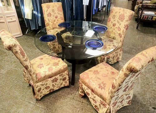 Stunning glass top table with 4 beautifully unique upholstered chairs!
