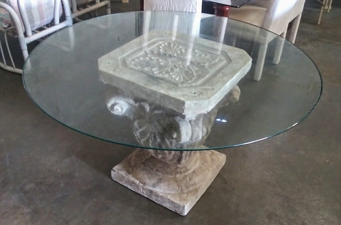 Unique glass top pedestal style dining room table