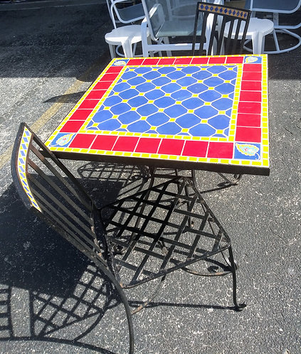 Vibrant wrought iron decorative table with 2 chairs