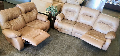 High quality leather reclining sofa and matching love seat