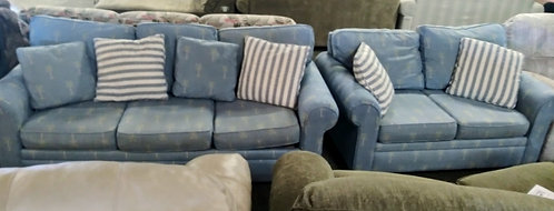 Palm tree patterned sofa and love seat, perfect for that beachy theme you want!