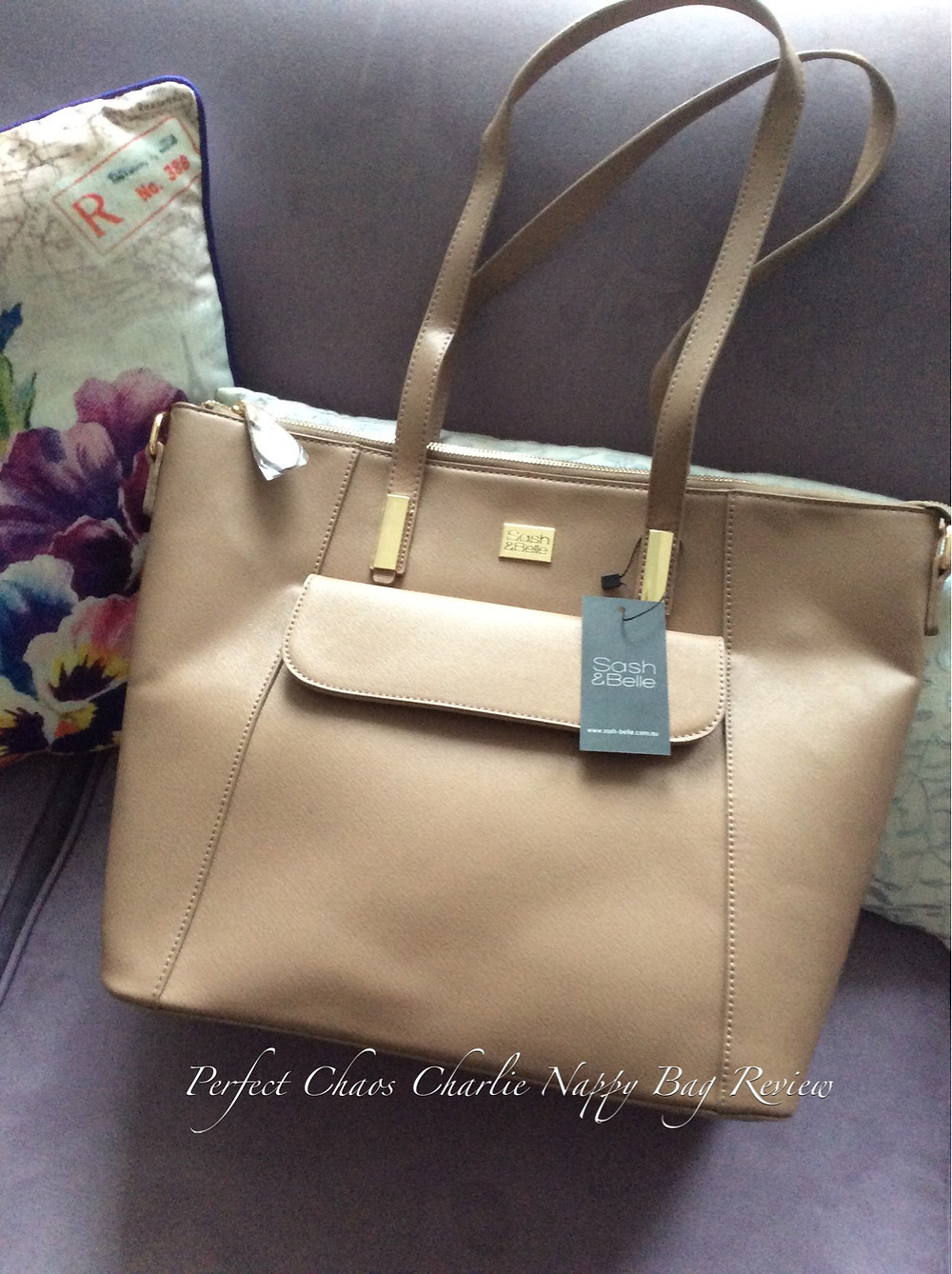 Front view of the Sash & Belle Charlie nappy bag in Taupe