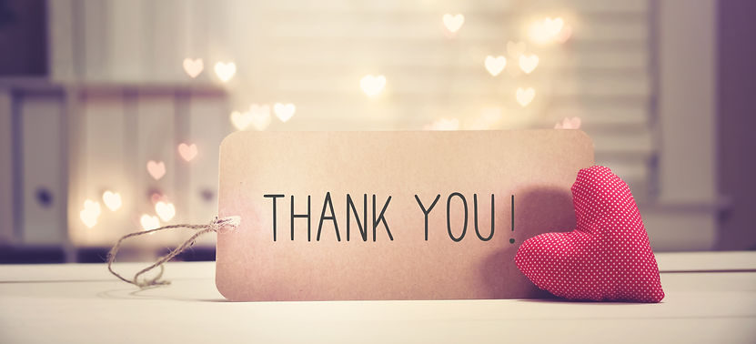 Thank You message with a red heart with