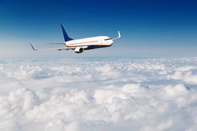 commercial-airplane-flying-above-clouds-