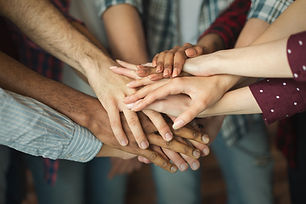 group-of-friends-holding-hands-together-