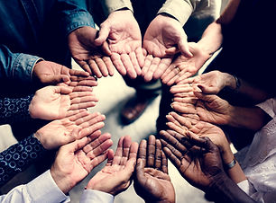group-of-diverse-hands-in-a-circle-PWEVJ