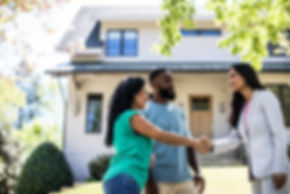 Couple meeting with real estate agent in