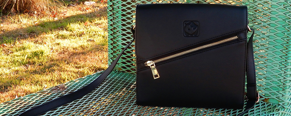 A signature shoulder bag by White Rhino in color 'Midnight'