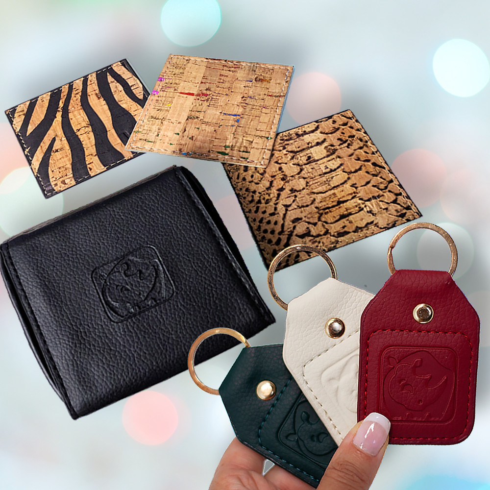A holiday gift set by White Rhino that includes cork leather coasters, vegan leather coaster case and set of three holiday key chains