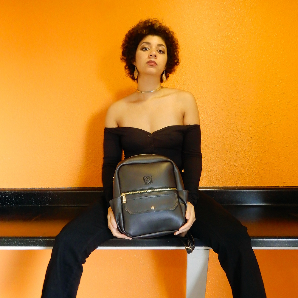 Claire Carreras, CEO of White Rhino poses with designer backpack