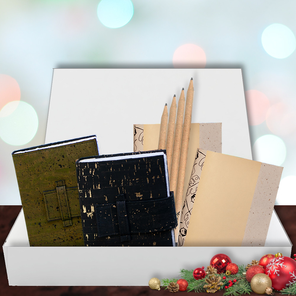 An eco journal gift set comes with two handmade cork leather journals, two refills and a set of 4 recycled paper pencils