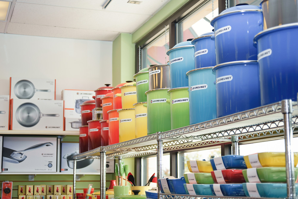 Shelves of Le Creuset pots and pans