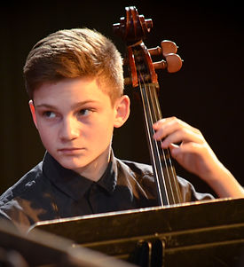 Young person playing cello.
