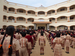 Prayer session in front of the school