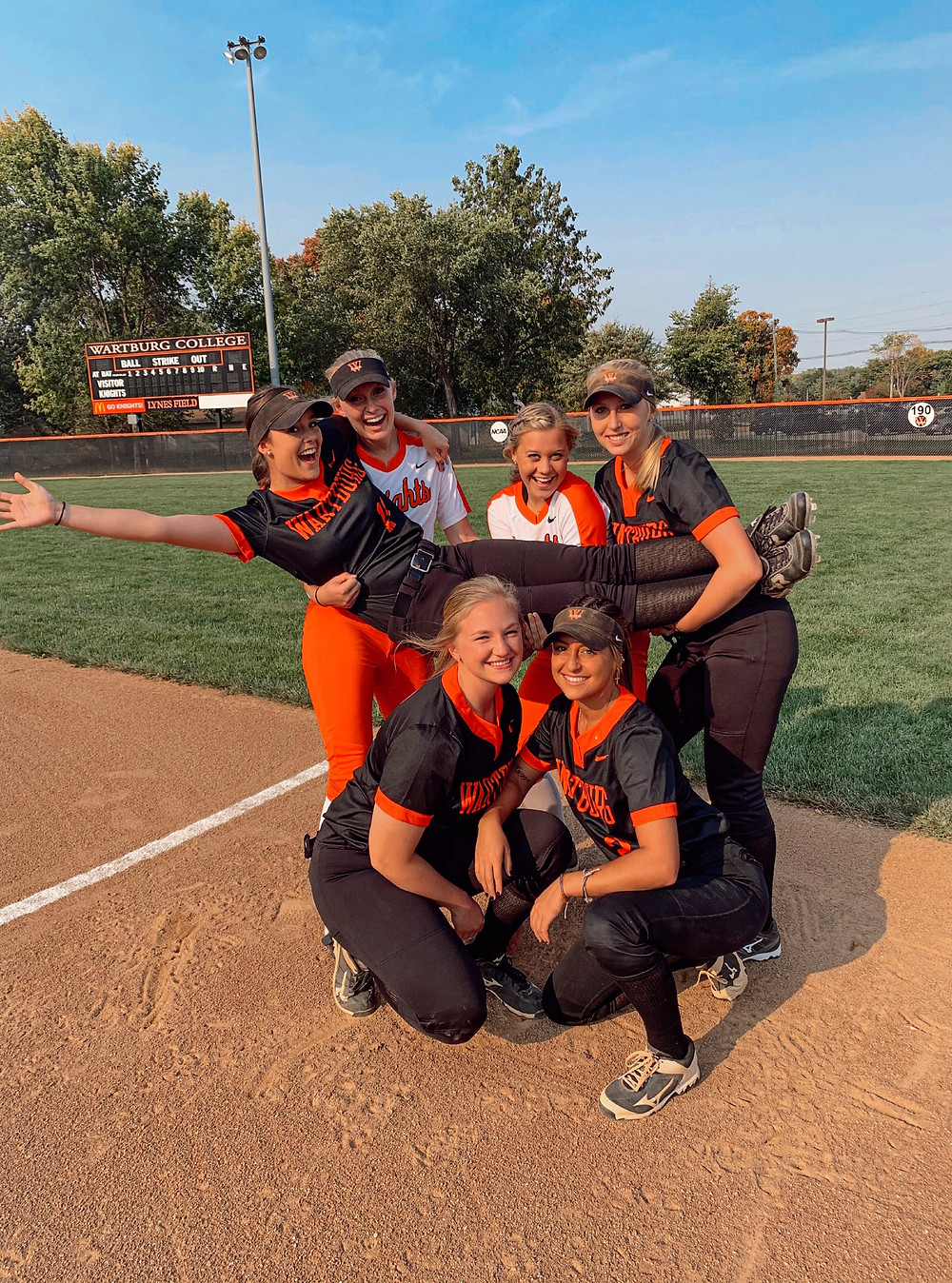 Lauren posing with her softball teammates.