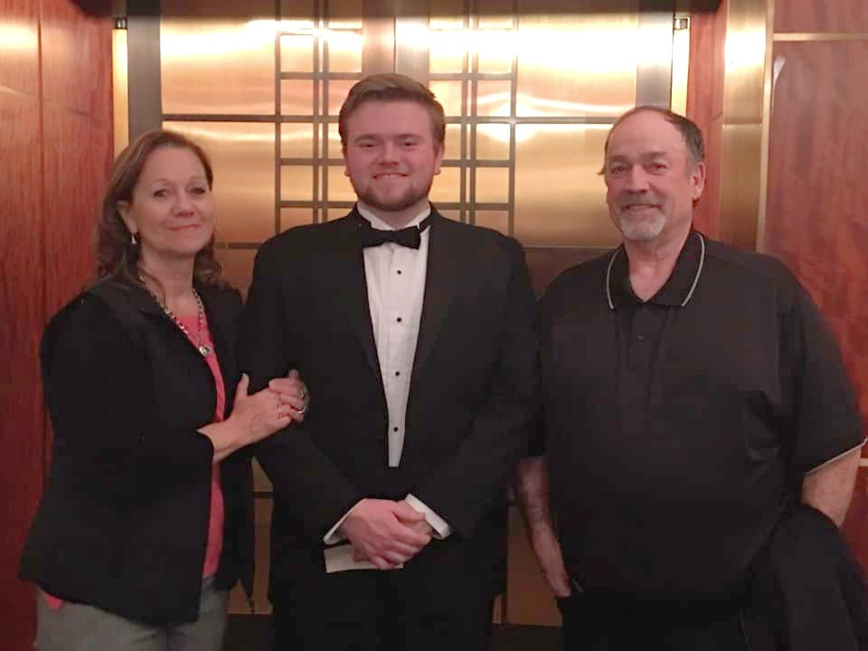 Dominic posing with grandparents after Carnegie Hall performance
