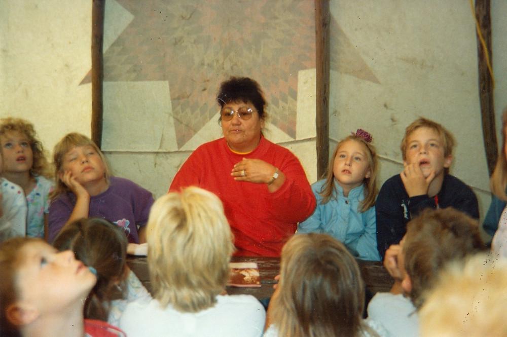 Maria Pearson teaching at a pow-wow in Mankato.