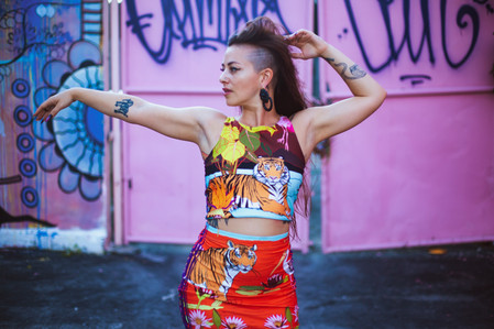 Jozie wearing crop top & the fitted skirt in Swamp Paradise print