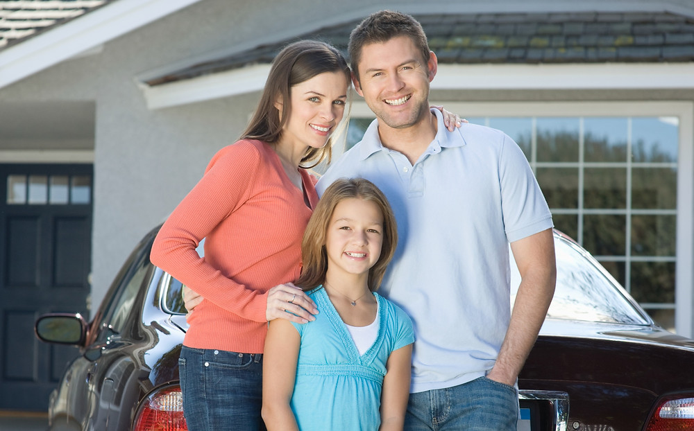 Family with car and house