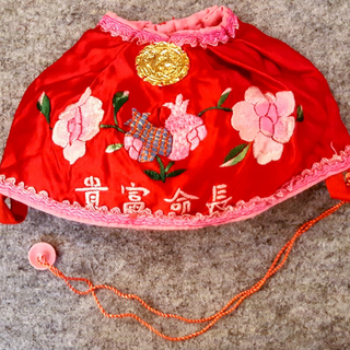 何兆基:繡花帽