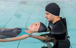 Hydrotherapy physiotherapist with female patient