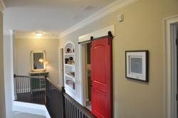 Upper level Hall view with barn door