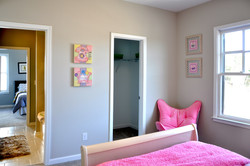 Girls Room with view of closet and bath entry