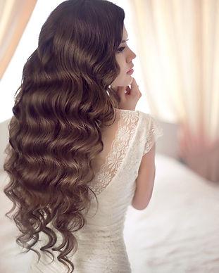 Beautiful brunette bride with long healt