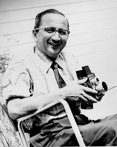 A middle-aged Emile Bocian posing with his Ricoflex Twin Lens.