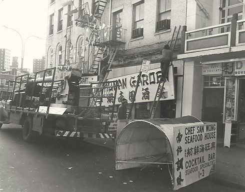 Photo of Hunan Garden restaurant being installed in Chinatown, NYC