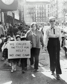 Schoolchildren march on 5th Precinct with Suzanne O'Reilly, school principal (right) and Susan Pankow, first grade teacher (left), October 18, 1984