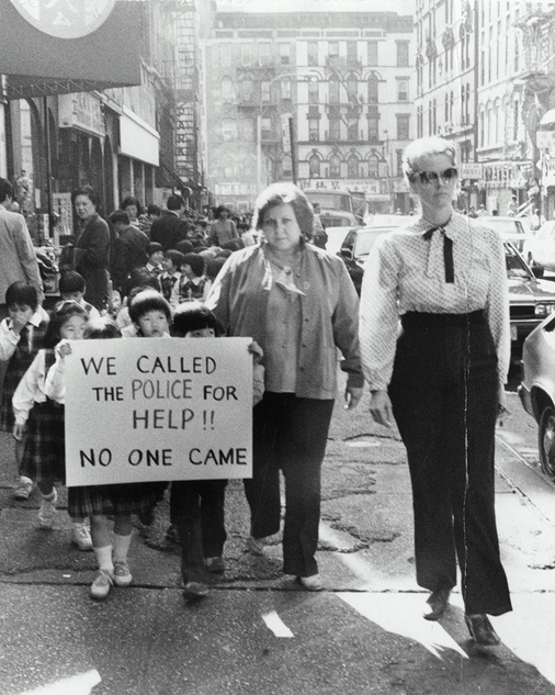 Schoolchildren march on 5th Precinct with Suzanne O'Reilly, school principal (right) and Susan Pankow, first grade teacher (left) October 18, 1984
