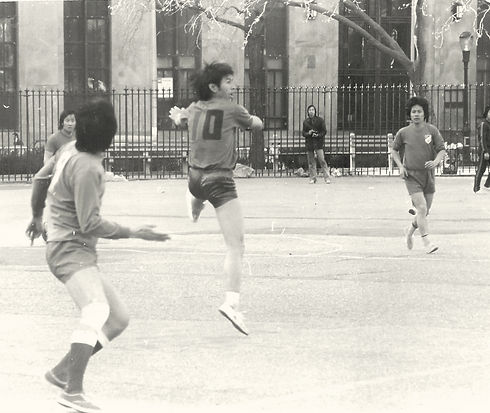 Men playing soccer in Chinatown, NYC