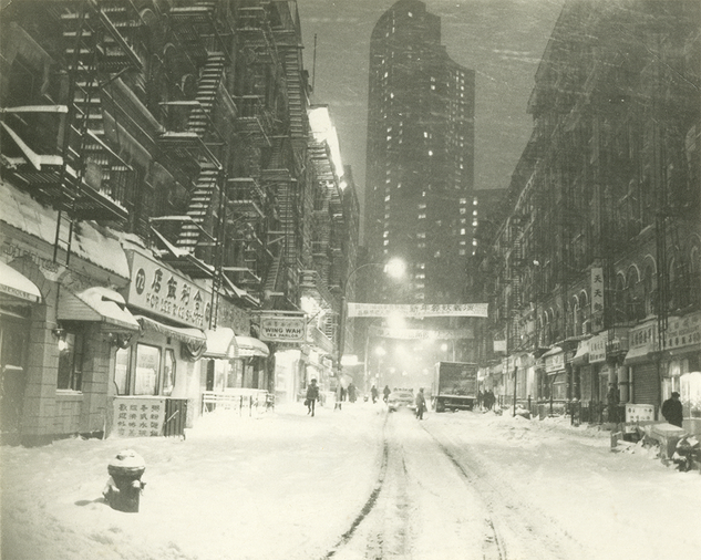 View of Bayard Street from Mott Street on a snowy night, date unknown