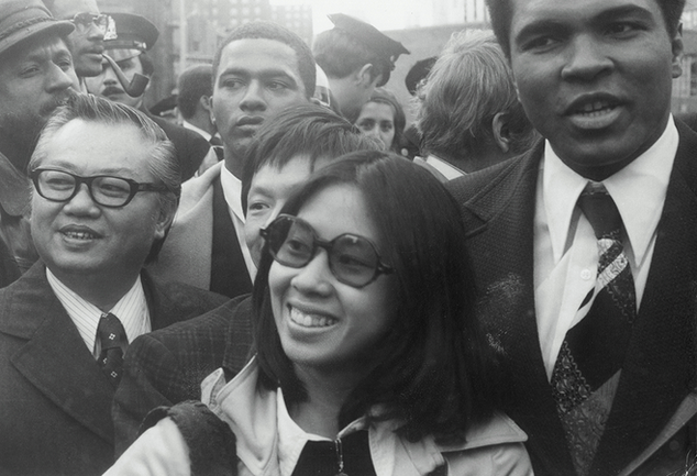 "Muhammad Ali with Linda J. Lee (center) and M.B. Lee (right), President of the Chinese Consolidated Benevolent Association, on ""Muhammad Ali Day,"" December 9, 1974"