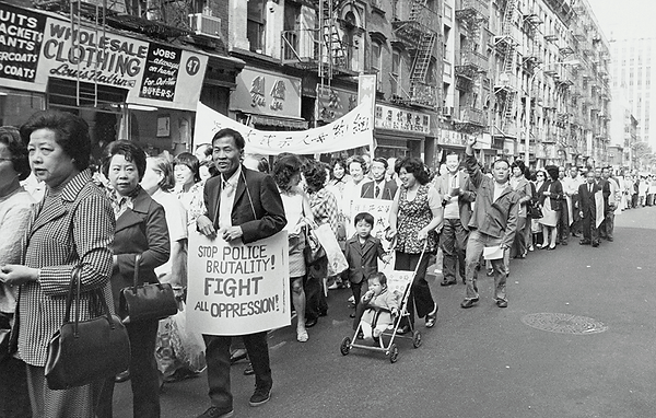 A long stream, hundreds deep, of protesters marching through the streets of Chinatown.