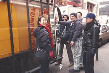MOCA staff transporting the glass sign to the MOCA colection