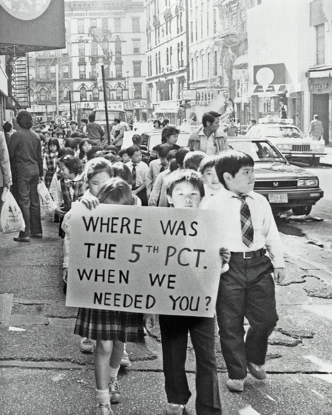 """Long line of young students protesting the police. Holding a sign """"Where was the 5th precinct when we needed you?"""""""