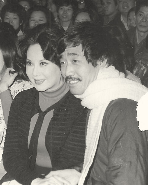 Photo of Li Li-Hua and Yuen Wah at an event in Chinatown, NYC