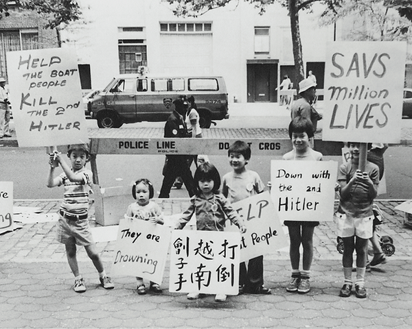"""A group of children protesting at the U.N. for Vietnamese boat people. Signs are in both english and chinese denouncing the """"2nd Hitler""""."""