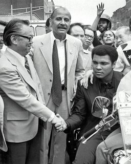"""Muhammad Ali with Percy Sutton (center) and M.B. Lee (left), President of the Chinese Consolidated Benevolent Association on """"Muhammad Ali Day,"""" December 9, 1974"""