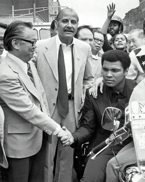 "Muhammad Ali with Percy Sutton (center) and M.B. Lee (left), President of the Chinese Consolidated Benevolent Association on ""Muhammad Ali Day,"" December 9, 1974."