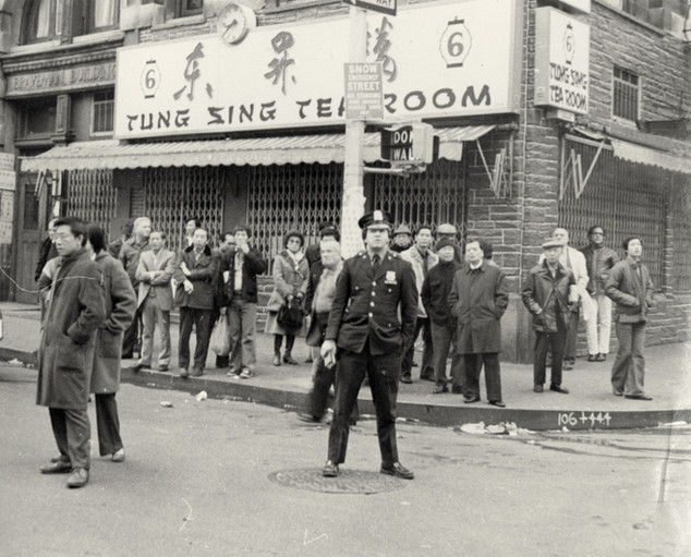 Parade watchers in front of 6 East Broadway, date unknown