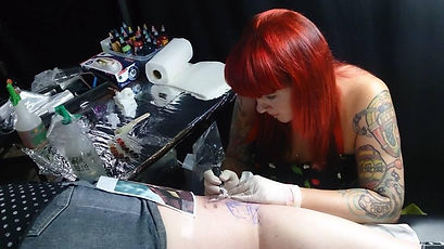 Busy at work at a tattoo convention