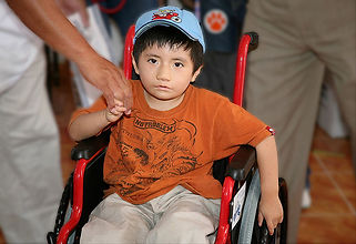 Wheelchair Foundation young boy in South America