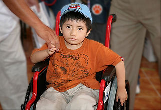 Young boy in donated wheelchair